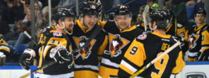 EIGHT DIFFERENT PENGUINS SCORE IN WIN OVER WOLF PACK