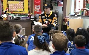 PENS PUT DOWN STICKS, OPEN UP BOOKS FOR READ ACROSS AMERICA