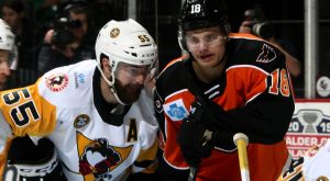 PENGUINS FALL TO PHANTOMS IN WILD, HIGH-SCORING GAME