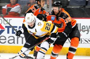 PENGUINS SLIDE PAST PHANTOMS WITH 2-1, OVERTIME WIN