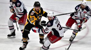HOT START LEADS PENGUINS PAST WOLF PACK, 4-1